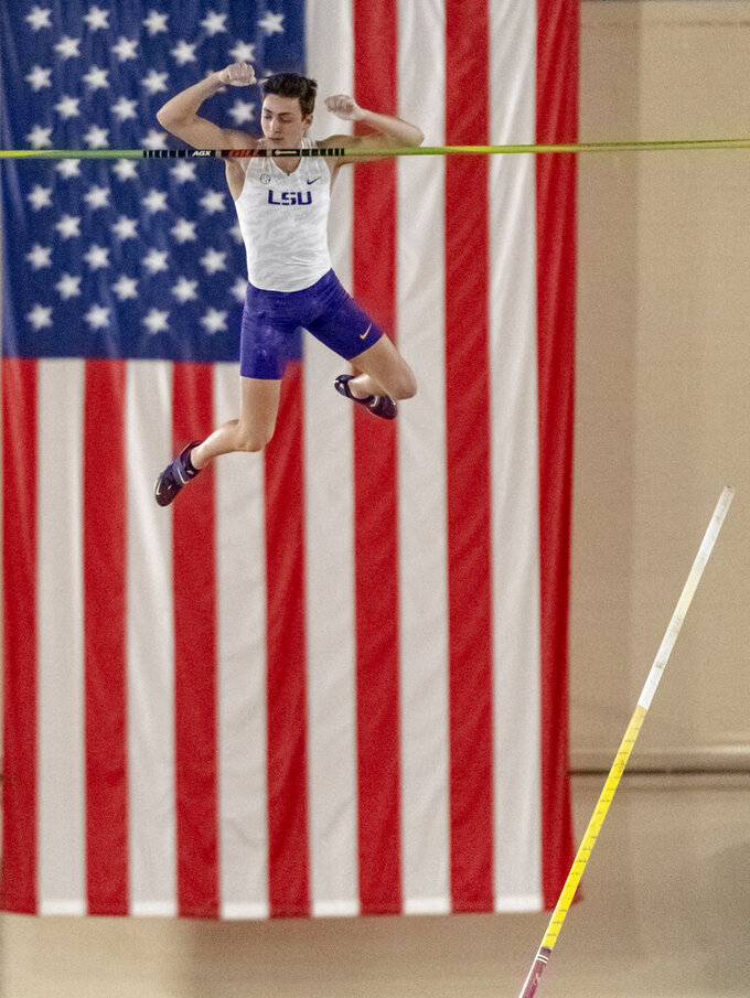 File-This March 8, 2019, file photo shows LSU's Mondo Duplantis competing in the men's pole vault during the NCAA Division I indoor track and field championships in Birmingham, Ala. Duplantis took silver at the world championships in Qatar. He's from Lafayette, Louisiana, and attended Louisiana State. He won gold at the 2015 World Youth Championships and holds many age-group records.  (AP Photo/Vasha Hunt, File)