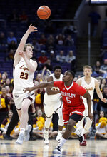 Loyola of Chicago's Cooper Kaifes (23) passes over Bradley's Darrell Brown (5) during the first half of an NCAA college basketball game in the semifinal round of the Missouri Valley Conference tournament, Saturday, March 9, 2019, in St. Louis. (AP Photo/Jeff Roberson)