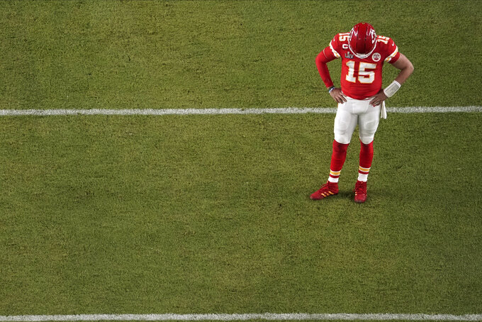 Kansas City Chiefs quarterback Patrick Mahomes (15) looks down, during the first half of the NFL Super Bowl 54 football game against the San Francisco 49ers, Sunday, Feb. 2, 2020, in Miami Gardens, Fla. (AP Photo/Morry Gash)