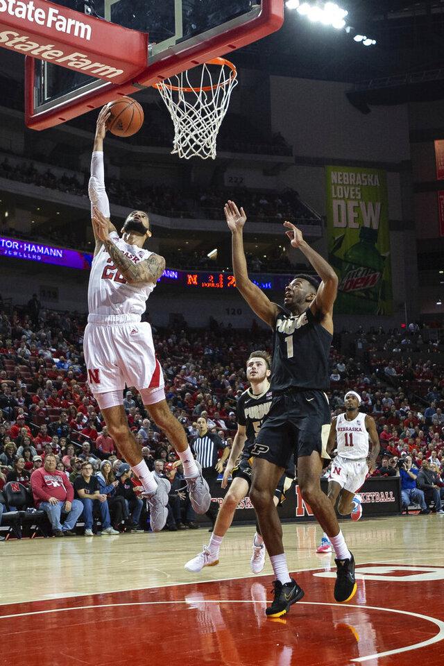 Nebraska guard Haanif Cheatham (22) makes a layup against Purdue forward Aaron Wheeler (1) during the first half of an NCAA college basketball game in Lincoln, Neb., Sunday, Dec. 15, 2019. (AP Photo/John Peterson)