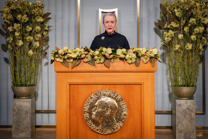 Nobel Committee chair Berit Reiss-Andersen makes a statement at the Nobel Institute as part of the digital award ceremony for this year's Peace Prize winner, the World Food Program (WFP), in Oslo, Norway, Thursday Dec. 10, 2020.  Reiss-Andersen makes a statement in Oslo as part of the Nobel Peace Prize digital award ceremony and an acceptance speech will be made by WFP Executive Director David Beasley in Rome, Italy. (Heiko Junge / NTB via AP)