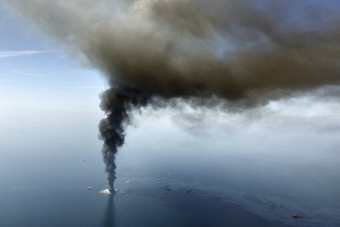 FILE - In this April 21, 2010, file photo, the Deepwater Horizon oil rig burns in the Gulf of Mexico. As oil spewed into the Gulf of Mexico from a blown-out BP well in 2010, residents wondered whether their home would ever be the same. The Deepwater Horizon disaster changed the region, with a flood of spending altering landscapes and attitudes. (AP Photo/Gerald Herbert, File)