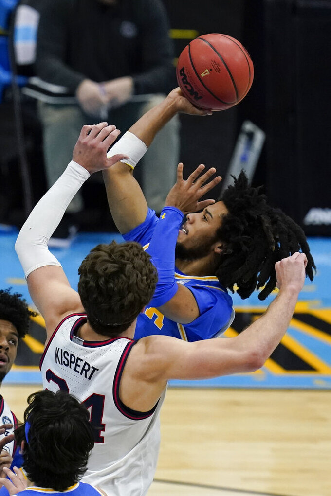UCLA guard Tyger Campbell shoots over Gonzaga forward Corey Kispert (24) during the first half of a men's Final Four NCAA college basketball tournament semifinal game, Saturday, April 3, 2021, at Lucas Oil Stadium in Indianapolis. (AP Photo/Michael Conroy)