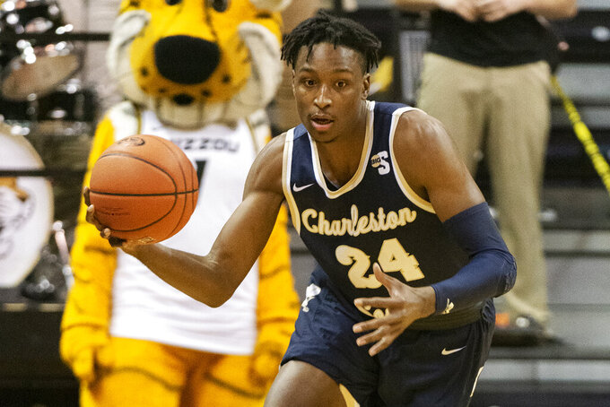 FILE - Charleston Southern's Phlandrous Fleming Jr. brings the ball up court during the first half of an NCAA college basketball game against Missouri in Columbia, Mo., in this Tuesday, Dec. 3, 2019, file photo. Florida added three defensive stalwarts via the NCAA transfer portal, led by two-time Big South defensive player of the year Phlandrous Fleming and Summit League defensive player of the year Brandon McKissic, to bolster a lineup the Gators believe will be able to compete in the stacked Southeastern Conference. (AP Photo/L.G. Patterson, File)