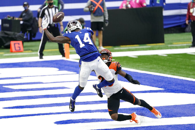 Indianapolis Colts' Zach Pascal (14) tries to make a catch while defended by Cincinnati Bengals' Darius Phillips (23) during the first half of an NFL football game, Sunday, Oct. 18, 2020, in Indianapolis. The pass was incomplete. (AP Photo/AJ Mast)