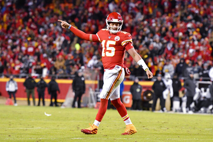 Kansas City Chiefs quarterback Patrick Mahomes (15) celebrates a touchdown by running back Darwin Thompson (34) during the second half of an NFL football game against the Oakland Raiders in Kansas City, Mo., Sunday, Dec. 1, 2019. (AP Photo/Ed Zurga)