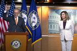 Senate Minority Leader Sen. Chuck Schumer of N.Y., joined by House Speaker Nancy Pelosi of Calif., speaks during a news conference on Capitol Hill in Washington, Thursday, Aug. 6, 2020. (AP Photo/Jose Luis Magana)