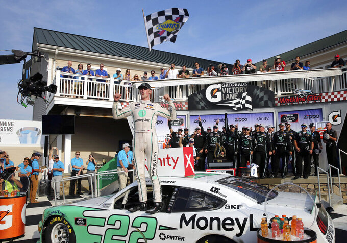 Austin Cindric celebrates his win in a NASCAR Xfinity Series auto race at Watkins Glen International, Saturday, Aug. 3, 2019, in Watkins Glen, N.Y. (AP Photo/John Munson)