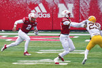 Nebraska quarterback Adrian Martinez (2) carries the ball as wide receiver Zavier Betts (15) blocks Minnesota defensive back Benjamin St-Juste (25) during the first half of an NCAA college football game in Lincoln, Neb., Saturday, Dec. 12, 2020. (AP Photo/Nati Harnik)
