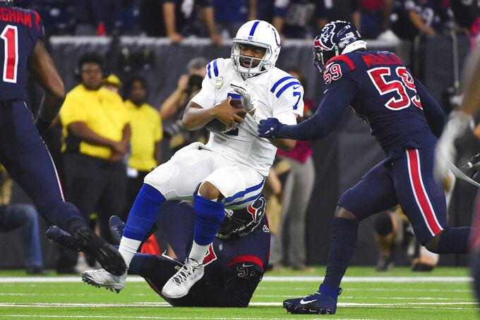 Indianapolis Colts quarterback Jacoby Brissett (7) is sacked by Houston Texans defensive end Angelo Blackson (97) during the first half of an NFL football game Thursday, Nov. 21, 2019, in Houston. (AP Photo/Eric Christian Smith)