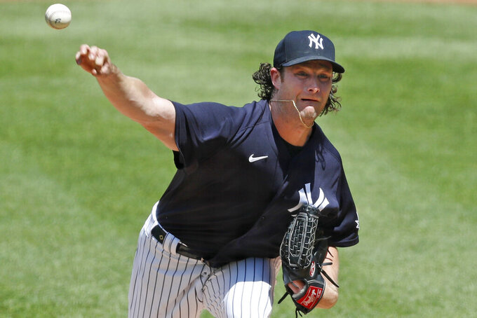 New York Yankees starting pitcher Gerrit Cole delivers during an intrasquad game in baseball summer training camp Sunday, July 12, 2020, at Yankee Stadium in New York. (AP Photo/Kathy Willens)