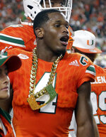 FILE - In this Nov. 11, 2017, file photo, Miami defensive back Jaquan Johnson (4) wears the turnover chain after making an interception during the first half of an NCAA college football game against Notre Dame, in Miami Gardens, Fla. College football sidelines across the country are featuring everything from wrestling-style robes to boxing gloves as teams conjure up creative ways to reward big plays.  It's not a new phenomenon but schools are jumping into the arena, trying to mimic the success Miami had last season with its turnover chain.  (AP Photo/Lynne Sladky, File)