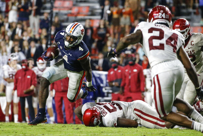 Auburn running back Tank Bigsby (4) carries the ball against Arkansas during the second half of an NCAA college football game Saturday, Oct. 10, 2020, in Auburn, Ala. (AP Photo/Butch Dill)