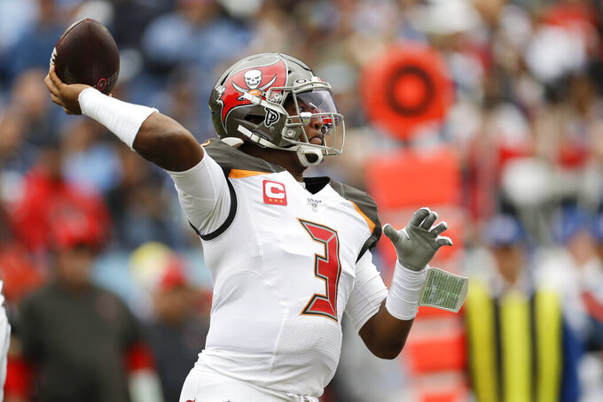 Tampa Bay Buccaneers quarterback Jameis Winston passes against the Tennessee Titans in the first half of an NFL football game Sunday, Oct. 27, 2019, in Nashville, Tenn. (AP Photo/James Kenney)
