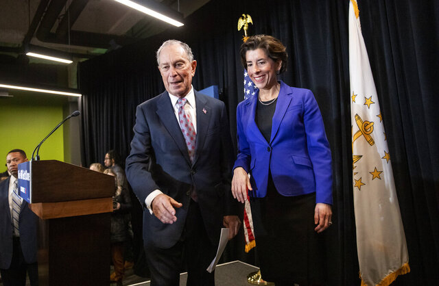 Rhode Island Gov. Gina Raimondo, right, joins Democratic presidential candidate and former New York City Mayor Michael Bloomberg onstage after introducing him at a campaign event Wednesday, Feb. 5, 2020, in Providence, R.I. (AP Photo/David Goldman)