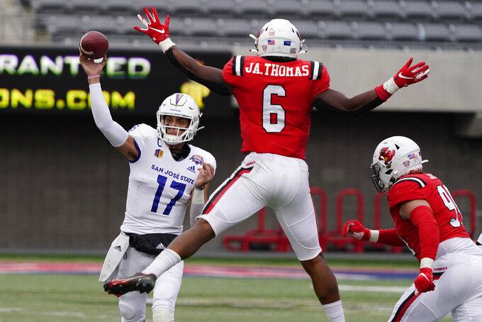 San Jose State quarterback Nick Starkel (17) throws around Ball State linebacker Jaylin Thomas (6) during the second half of the Arizona Bowl NCAA college football game Thursday, Dec. 31, 2020, in Tucson, Ariz. Ball State won 34-13. (AP Photo/Rick Scuteri)