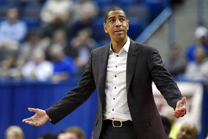 FILE - In this Feb. 15, 2018, file photo, Connecticut head coach Kevin Ollie reacts during the second half an NCAA college basketball game against Tulsa in Hartford, Conn. An NCAA panel on Wednesday, May 6, 2020 rejected an appeal by former UConn men's basketball coach Kevin Ollie, who sought to overturn findings that he violated ethical conduct rules while leading the Huskies.. (AP Photo/Jessica Hill, File)