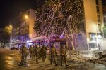 Police walk amid the destruction caused during anti-government protests in Santiago, Chile, Monday, Oct. 28, 2019. Fresh protests and attacks on businesses erupted in Chile Monday despite President Sebastián Piñera's replacement of eight important Cabinet ministers with more centrist figures, and his attempts to assure the country that he had heard calls for greater equality and improved social services. (AP Photo/Rodrigo Abd)