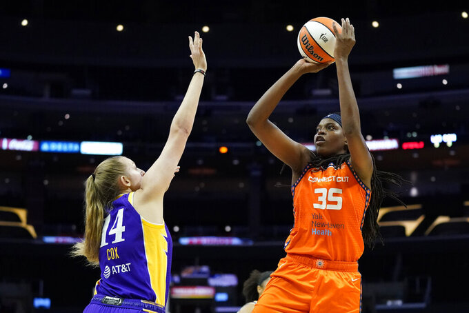 Connecticut Sun forward Jonquel Jones (35) shoots over Los Angeles Sparks forward Lauren Cox (14) during the first half of WNBA basketball game Thursday, Sept. 9, 2021, in Los Angeles. (AP Photo/Ashley Landis)