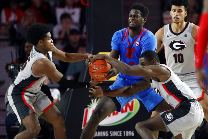 Mississippi forward Khadim Sy (3) competes for the ball with Georgia's Sahvir Wheeler (15) and Jordan Harris (2) during an NCAA college basketball game in Athens, Ga., Saturday, Jan. 25, 2020. (Joshua L. Jones/Athens Banner-Herald via AP)
