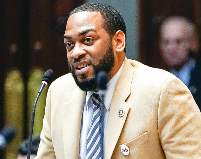 FILE - In this Feb. 19, 2020, file photo, state Rep. Charles Booker speaks on the floor of the House of Representatives in the State Capitol in Frankfort, Ky. Looking to flex his newfound influence after his Senate campaign fell just short, Booker reached out Thursday, July 2, 2020 to help unite Kentucky Democrats behind Amy McGrath's uphill fight to unseat Republican Senate Majority Leader Mitch McConnell. (AP Photo/Bryan Woolston, File)