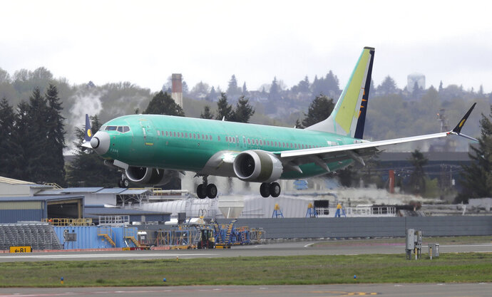 FILE - In this April 10, 2019 photo, a Boeing 737 MAX 8 airplane being built for India-based Jet Airways lands following a test flight at Boeing Field in Seattle. Boeing and the Federal Aviation Administration are both partly at fault for the failures of the 737 Max, the plane model involved in two fatal crashes, according to a new report. The New York Times said Friday, Oct. 11  that a multiagency task force found that Boeing didn't appropriately explain the plane's new automated system to regulators, and the FAA didn't have the capability to effectively analyze much of what Boeing did share about the plane. (AP Photo/Ted S. Warren, File)