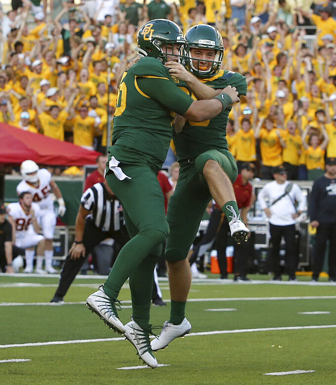 Baylor long snapper Ross Matiscik, left, and Baylor place kicker John Mayers, right, celebrate after making a field goal to beat Iowa State in an NCAA college football game, Saturday, Sept. 28, 2019, in Waco, Texas. (Jerry Larson/Waco Tribune-Herald via AP)