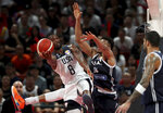 United States' Harrison Barnes is blocked by Greece's Giannis Antetokounmpo during phase two of the FIBA Basketball World Cup at the Shenzhen Bay Sports Center in Shenzhen in southern China's Guangdong province on Saturday, Sept. 7, 2019. United States beat Greece 69-53. (AP Photo/Ng Han Guan)