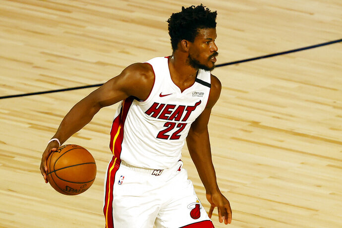 Miami Heat's Jimmy Butler dribbles up court during the first half of an NBA basketball game against the Denver Nuggets, Saturday, Aug. 1, 2020, in Lake Buena Vista, Fla. (Kevin C. Cox/Pool Photo via AP)