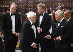 From left, Britain's Prince William, Sir David Attenborough, Prince Harry, and Prince Charles meet on the steps of the Natural History Museum in central London, for the premiere of a new series of Our Planet, Thursday, April 4, 2019. (Photo by Joel C Ryan/Invision/AP)