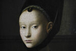 """Detail of the painting by Petrus Christus titled Portrait of a Young Woman, around 1470, during a press preview of the Remember Me exhibit at the Rijksmuseum in Amsterdam, Netherlands, Tuesday, Sept. 28, 2021. As COVID-19 lockdowns ease and borders reopen, there is a gathering at Amsterdam's Rijksmuseum of people from around Europe, depicted in more than 100 Renaissance portraits. The Dutch national museum's new exhibition """"Remember Me,"""" covers the century 1470-1570. (AP Photo/Peter Dejong)"""