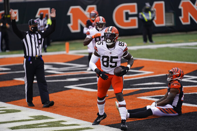 Cleveland Browns' David Njoku (85) celebrates a touchdown reception during the second half of an NFL football game against the Cincinnati Bengals, Sunday, Oct. 25, 2020, in Cincinnati. (AP Photo/Bryan Woolston)