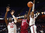 Massachusetts' Samba Diallo, center, shoots between St. John's Marcellus Earlington, left, and Josh Roberts, right, during the first half of an NCAA college basketball game, Sunday, Nov. 24, 2019, in Uncasville, Conn. (AP Photo/Jessica Hill)