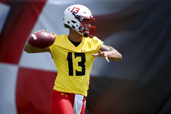 FILE - In this Aug. 2, 2019, file photo, Maryland quarterback Tyler DeSue works out during a NCAA college football training camp in College Park, Md. Coming off the darkest season in the history of the Maryland football program, the Terrapins are poised to enter a new era under Mike Locksley, hired in December after a successful run as Alabama's offensive coordinator, who remembers what it was like when the team competed for conference titles and counted on playing in bowl games. (AP Photo/Will Newton, File)