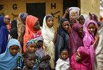 Women queue in line to cast their votes in the village of Tumfafi, near Kano, in northern Nigeria, Saturday, Feb. 23, 2019. Nigerians are going to the polls for a presidential election Saturday, one week after a surprise delay for Africa's largest democracy. (AP Photo/Ben Curtis)