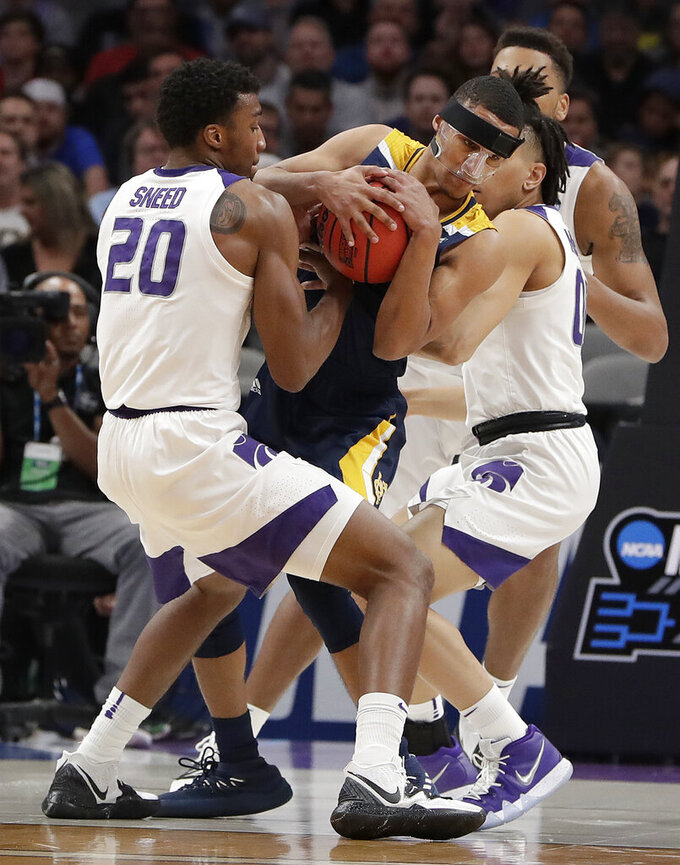 UC Irvine guard Eyassu Worku, center, is defended by Kansas State forward Xavier Sneed (20) during the first half of a first round men's college basketball game in the NCAA Tournament Friday, March 22, 2019, in San Jose, Calif. (AP Photo/Chris Carlson)