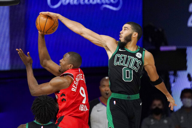 Boston Celtics' Jayson Tatum (0) blocks the shot of Toronto Raptors' Serge Ibaka (9) during the second half of an NBA conference semifinal playoff basketball game Monday, Sept. 7, 2020, in Lake Buena Vista, Fla. (AP Photo/Mark J. Terrill)