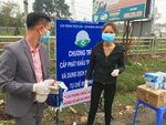 Health officials stand in front of a warning sign about the COVID-19 disease at a checkpoint before entering the Son Loi commune in Vinh Phuc province, Vietnam on Thursday, Feb. 13, 2020. 0fficial media reported that the Son Loi commune with 10,000 residents northwest of the capital Hanoi was put in lockdown due to a cluster of cases there. Vietnam has confirmed 16 cases of the disease. (AP Photo/Yves Dam Van)