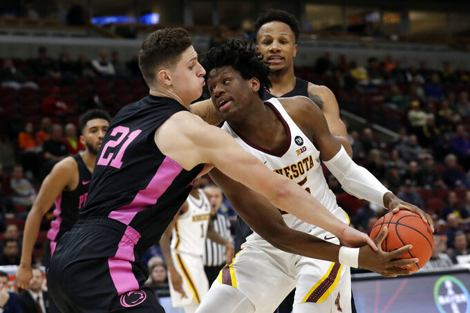 Minnesota's Daniel Oturu (25) battles for the ball against Penn State's John Harrar (21) during the second half of an NCAA college basketball game in the second round of the Big Ten Conference tournament, Thursday, March 14, 2019, in Chicago. (AP Photo/Nam Y. Huh)