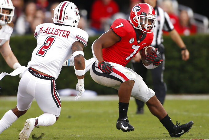 Georgia running back D'Andre Swift (7) moves the ball against Massachusetts during the first half of an NCAA college football game against Massachusetts, Saturday, Nov. 17, 2018, in Athens, Ga. (Joshua L. Jones/Athens Banner-Herald via AP)