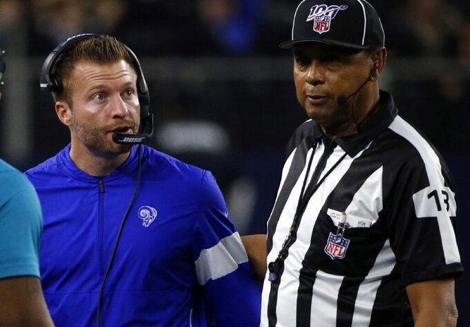 Los Angeles Rams head coach Sean McVay, left, talks with an official in the second half of an NFL football game against the Dallas Cowboys in Arlington, Texas, Sunday, Dec. 15, 2019. (AP Photo/Michael Ainsworth)