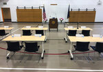 Desks for the Alaska state representatives who are not attending the special session in Juneau are set up inside a small gym at Wasilla Middle School in Wasilla, Alaska, on Monday, July 8, 2019. In a rare move, nearly a third of Alaska lawmakers are expected to buck their leadership in both chambers and meet Monday in Wasilla even though a majority of lawmakers will convene the special session in Juneau, the state capital, about 600 miles away. (AP Photo/Mark Thiessen)