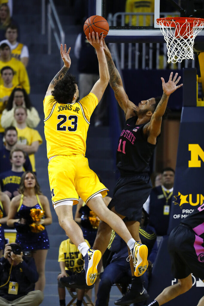 Michigan forward Brandon Johns Jr. (23) drives on Penn State forward Lamar Stevens (11) in the first half of an NCAA college basketball game in Ann Arbor, Mich., Wednesday, Jan. 22, 2020. (AP Photo/Paul Sancya)