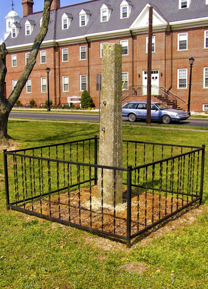 In this undated photo from the Delaware Division of Historical & Cultural Affairs a whipping post is displayed on the grounds of the Old Sussex County Courthouse near the Circle in Georgetown, Del. Delaware officials are set to remove the post that was historically used to hold people as they were publicly lashed for committing crimes. The Delaware Division of Historical and Cultural Affairs says it will bring down the concrete post on Wednesday, July 1, 2020 and place it in a Dover storage unit with other historical artifacts, according to a statement issued by the agency Tuesday, June 30. (Delaware Division of Historical & Cultural Affairs via AP)