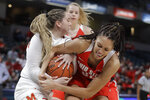 Maryland's Faith Masonius, left, and Ohio State's Aaliyah Patty battle for a rebound during the first half of an NCAA college basketball championship game at the Big Ten Conference tournament, Sunday, March 8, 2020, in Indianapolis. (AP Photo/Darron Cummings)