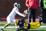 Michigan State wide receiver Ricky White (7) makes a catch while defended by Michigan defensive back Jalen Perry (16) during the second half of an NCAA college football game, Saturday, Oct. 31, 2020, in Ann Arbor, Mich. (AP Photo/Carlos Osorio)