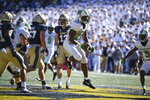 Marshall running back Rasheen Ali (22) scores his third first half touchdown against Navy during an NCAA college football game, Saturday, Sept. 4, 2021, in Annapolis, Md. (AP Photo/Terrance Williams)