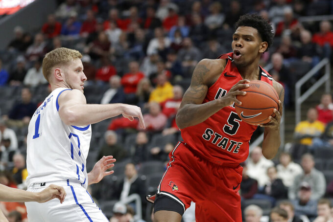 Illinois State's Keith Fisher III (5) looks to pass around Drake's Antonio Pilipovic during the second half of an NCAA college basketball game in the first round of the Missouri Valley Conference men's tournament Thursday, March 5, 2020, in St. Louis. (AP Photo/Jeff Roberson)