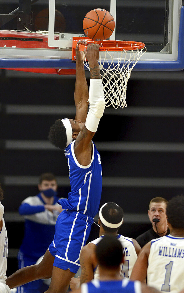 FILE - Drake's Shanquan Hemphill, top, drives to the basket against Indiana State during an NCAA college basketball game in Terre Haute, Ind., in this Sunday, Dec. 27, 2020, file photo. Drake is 15-0 for its best start in program history. Hemphill is Drake's leading scorer at 14.7 points per game.(Joseph C. Garza/The Tribune-Star via AP, File)