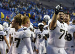 Central Florida defensive back Jonathan Gebka (47) and offensive lineman Wyatt Miller (78) celebrate after the team's win against Memphis in an NCAA college football game Saturday, Oct. 13, 2018, in Memphis, Tenn. Central Florida won 31-30. (AP Photo/Mark Zaleski)